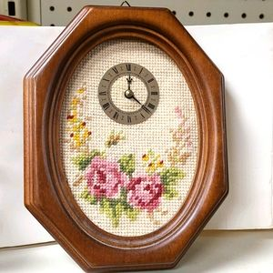Decorative needlepoint rose framed in a oval o'clo